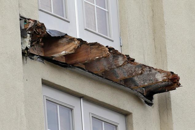 The broken timer beams of the collapsed balcony in Berkeley where six Irish students lost their lives