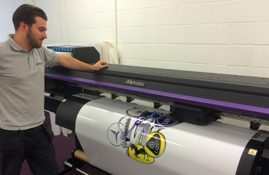 Lustalux's Sign & Graphics Assistant, Jonny Borg with the company's new Mimaki CJV300 printer/cutter