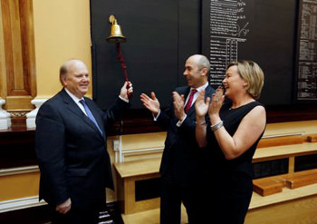 Minister for Finance Michael Noonan rings the bell of the ISE at the launch of Hibernia REIT watched by Kevin Nowlan CEO Hibernia REIT and Deirdre Somers Chief Executive of the ISE