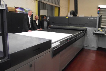 James Newton, sales manager, Connect Packaging with Jitha Singh, managing director and Ann Winder, business development director, with the company's new HP Scitex FB7600 Industrial Press